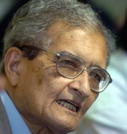Indian economist Amartya Sen listens to